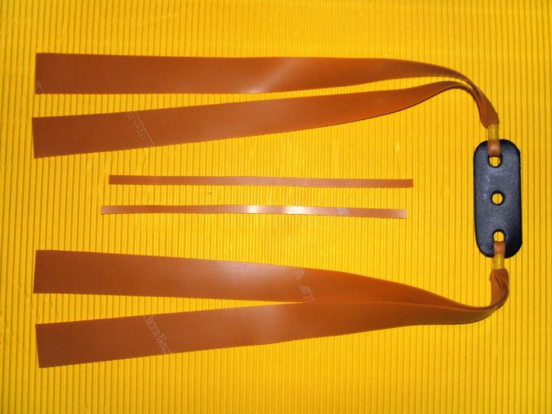 handgefertigter 2 fach flachbandgummi f r schleuder zwille thera band gold l nge 28 cm www. Black Bedroom Furniture Sets. Home Design Ideas